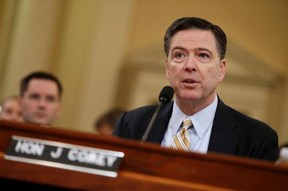 米下院の公聴会で証言するコミーFBI長官=20日、ワシントン(ロイター=共同)